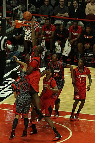Noah Vonleh's goaltending violation gives Nigel Williams-Goss a layup at the 2013 McDonald's All-American Boys Game. 20130403 MCDAAG Noah Vonleh's goaltending gives Nigel Williams-Goss a layup.JPG