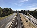 2018-10-25 11 22 25 View east along Interstate 66 (Custis Memorial Parkway) and the Orange and Silver lines of the Washington Metro from the overpass for 25th Street in Arlington County, Virginia.jpg