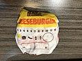 2019-02-28 21 44 52 A Burger King cheeseburger still in its wrapper in Oak Hill, Fairfax County, Virginia.jpg