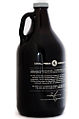 64 fluid ounce Growler style beer bottle in brown glass with a screw top cap.jpg