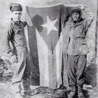Flag of Puerto Rico - Two members of the 65th Infantry pose with the flag during the Korean War