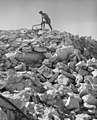 A-soldier-digging-in-rock-land-with-machine-352128850820.jpg