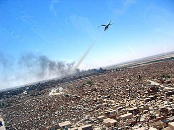 AH-1W Super Cobra attacks an enemy mortar position at Wadi-us-Salaam cemetery.jpg