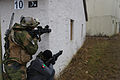 A Norwegian soldier and a Moldovan soldier, both acting as Afghan National Police officers, provide security during a military adviser team (MAT) and police adviser team (PAT) training exercise at the Hohenfels 131211-A-RJ750-021.jpg