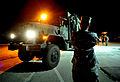 A U.S. Soldier with the 10th Air and Missile Defense Command gives signals to the driver of a vehicle while loading a truck at Hatzor Israeli Air Force Base, Israel 121108-F-QW942-176.jpg