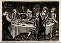 A family sits at the dinner table where the son is being wel Wellcome V0038780.jpg