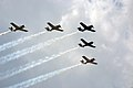 A formation of T-28 Trojans from the Trojan Horsemen Demo Team buzzes the crowd during a rehearsal for the Super Saturday Air Show, at Fort Campbell, Ky., Aug. 10, 2012 120810-A-ZT847-396.jpg