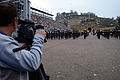 A member of the Turkish press, left, films a performance by the U.S. Naval Forces Europe Band on the second official show night for the Royal Edinburgh Military Tattoo 120804-N-VT117-106.jpg