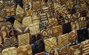 The Amazing Race 17 - In the Language Arts Detour, teams had to find a set of eight adinkra symbols (as carved at the Calabash stamps in Ntonso, Ghana) in a massive puzzle akin to a word search.