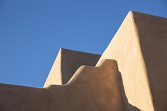 Pueblo Revival architecture - detail of adobe architecture, La Fonda, Santa Fe, NM