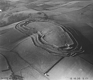 Maiden Castle, Dorset - The white line across the hill fort where the ramparts deviate inwards marks the extent of the early fort. Photograph taken in 1935 by Major George Allen (1891–1940).