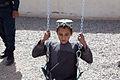 Afghan police build swing set for boys school 120517-M-DM345-018.jpg