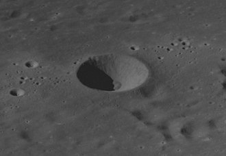 Al-Marrakushi (crater) - Apollo 8 image.  The clusters of small craters to the left and right are secondary craters from Langrenus.