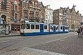 Amsterdam Magna Plaza Op lijn 5 GVB 11G tram 910 (29080335780).jpg