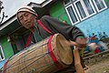 An aged man playing Chyabrung Drum, Yuksom, West Sikkim, India.jpg