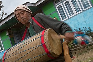 Limbu people - An aged man playing Chyabrung Drum, Yuksom, West Sikkim.