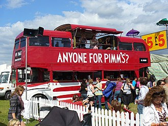 Pimm's - A Pimm's stand set up in a music festival using a converted bus as a bar area.