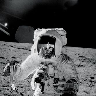 Apollo 12 - Alan Bean photographed by Pete Conrad (reflected in Bean's helmet)
