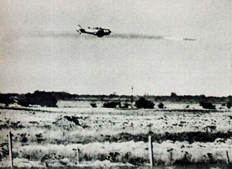 1963 Argentine Navy revolt - A rebel AT-6 combat trainer attacks a column of vehicles