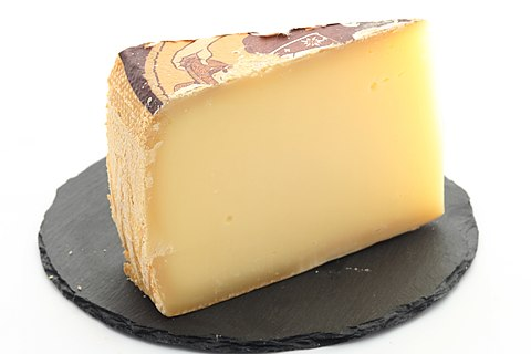 A wedge of gruyère cheese