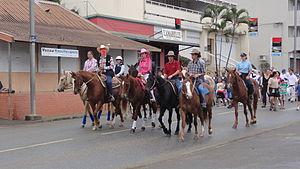 "Caldoche - Caldoche ""bushmen"" cavaliers carrying the 2011 Pacific Games flame in Bourail"