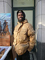 Artist Kolongi Brathwaite and his painting Freedom Riders at Inauguration 2013.jpg