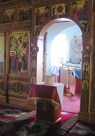 Artos - Paschal Artos, between services during bright Week, in front of opened royal doors.