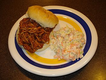 Pulled pork in BBQ sauce sandwich with slaw