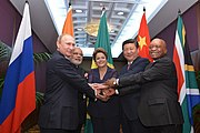 BRICS heads of state and government hold hands ahead of the 2014 G-20 summit in Brisbane, Australia