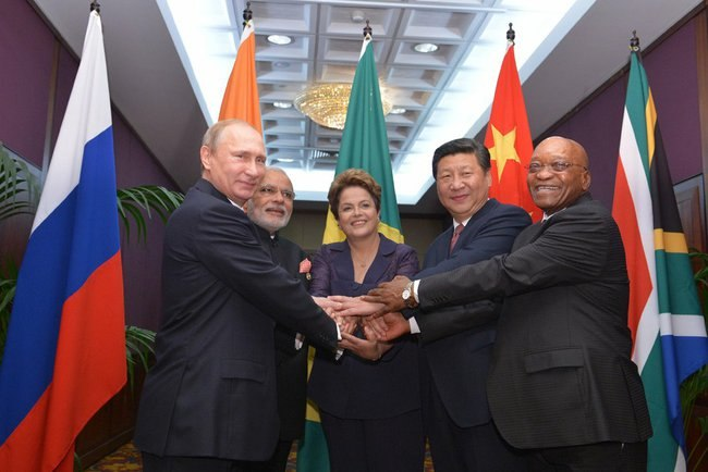 BRICS heads of state and government hold hands ahead of the 2014 G-20 summit in Brisbane, Australia.jpeg