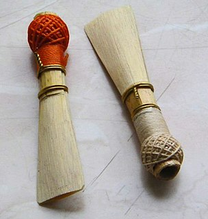 Double reed Type of reed used to produce sound in various wind instruments