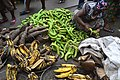 Bayam Sellam woman selling green banana and ripe plantain.jpg