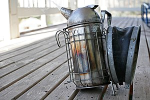 Bee smoker - A bee smoker with protective wire grid.