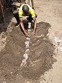 Benin Bronze Smith At Work 02.jpg