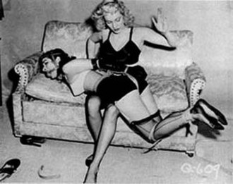 Fetish model - Bettie Page is tied and spanked in an image from Bizarre.