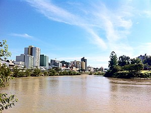 Blumenau - Itajaí-Açu river seen from the surroundings of Garcia's stream mouth; city centre at left