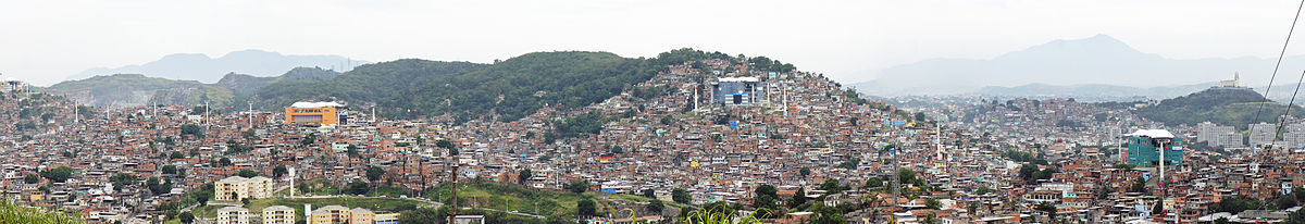 Panoramic view of the complex of favelas called Complexo do Alemão, with about 70,000 inhabitants (2010). The image shows the lines of the cable car system between the stations.