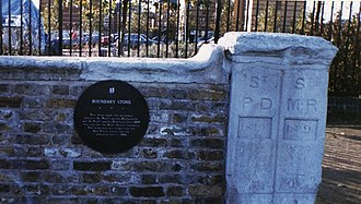 River Peck - This stone marks the boundary between St Mary's parish, Rotherhithe and St Paul's parish, Deptford. Until 1899 this was also the Kent-Surrey boundary. The stone was on a bridge over the Earl Creek nearby, but was relocated here in 1988.