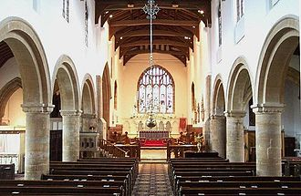 Ormulum - The interior of the church of Bourne Abbey, where the Ormulum was composed: the two nave arcades, although now whitewashed, remain from the church Orm would have known.