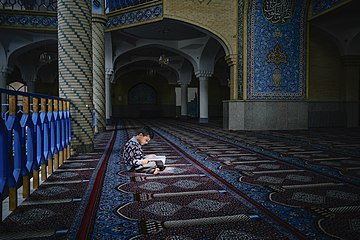 Boy in Dar ul-Ihsan Mosque.jpg