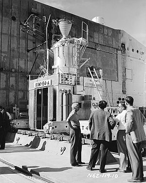 NERVA - The Director of the Los Alamos National Laboratory, Norris Bradbury (left) in front of the Kiwi B4-A reactor