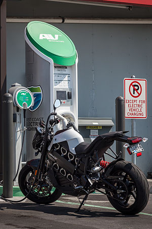 Plug-in electric vehicle - Brammo Empulse electric motorcycle at a charging station.