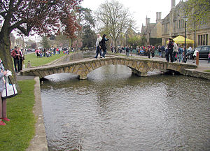 River Windrush - A pedestrian bridge across the River Windrush at Bourton on the Water