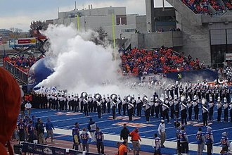 2008 Boise State Broncos football team - The Broncos take the field through the fog during the 2008 season.