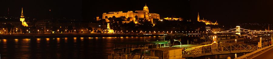 Budapest in the night from the Danube Promenade, from the left Tabán Church, Naphegy, Buda Castle