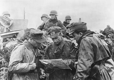 German field commanders plan the advance. Bundesarchiv Bild 183-J28477, Ardennenoffensive, Lagebesprechnung.jpg