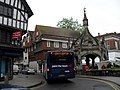 Bus passing the Market Cross - geograph.org.uk - 1906066.jpg