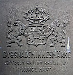 Listed buildings in Sweden - Sign for a Byggnadsminne by Turkiska kiosken in Hagaparken. The sign says: Byggnadsminne – Protected by decision of the King in Council