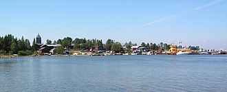 Holmöarna - Byviken village with the yellow ferry to the right and the Ship Museum to the left