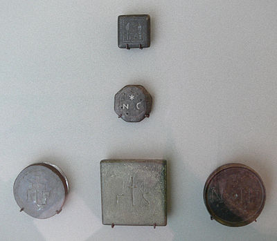 Five bronze commodity weights